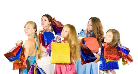 Rear view of girls holding shopping bags photo