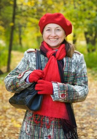 Portrait of senior woman  in autumn park Banco de Imagens