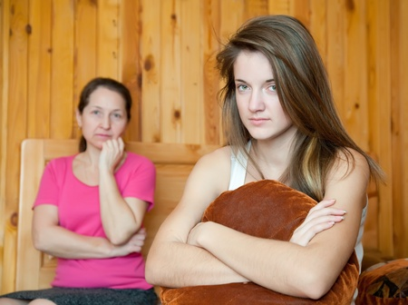 fracas: teenager daughter and mother after quarrel at home Stock Photo