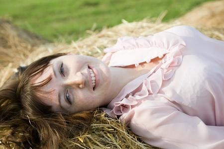barn girls: country girl on fresh hay at field