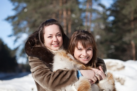 Portrait of  two smiling girls in winter photo