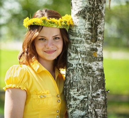 teener: Brunette teen girl in  flowers wreath  near birch