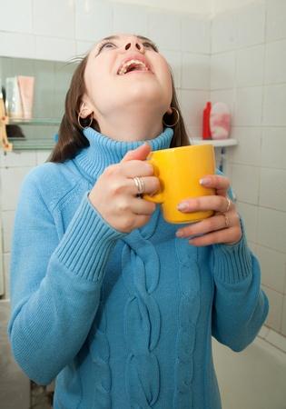 catarrh: Illness girl gargling throat in her bath