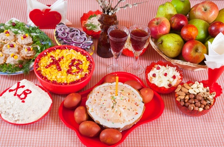 holiday meal: Easter table with celebrate cake  and holiday meal