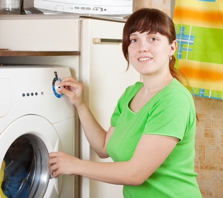Young woman doing laundry at her home Stock Photo - 9060670