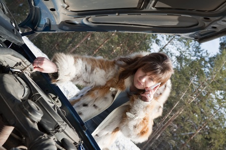 Young  woman trying to fix the car Stock Photo - 9061246