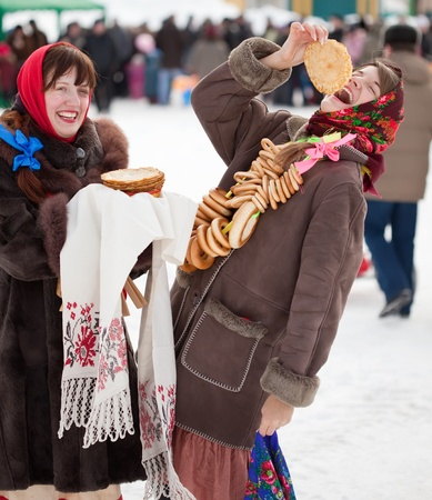 sudarium: Young woman eating pancake during  Shrovetide at Russia