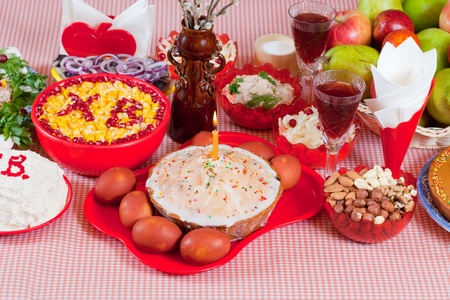 Easter table with celebrate cake  and other foods photo