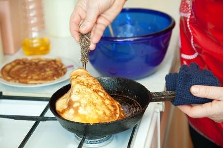 fryingpan:  Closeup of woman woman cooking pancakes