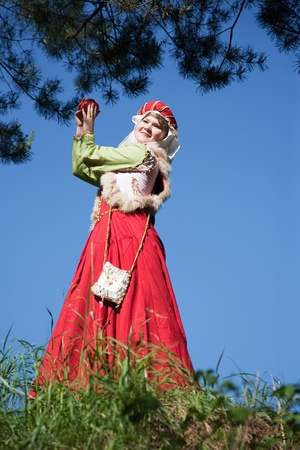 girl in european historical clothing  of XIII century at nature 스톡 콘텐츠