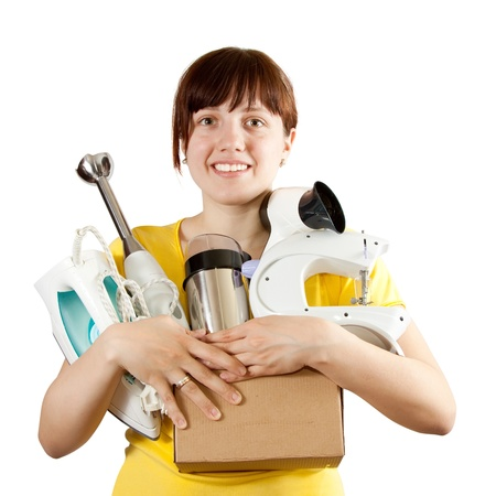 electric dryer: young woman with heavy-handed of household appliances over white