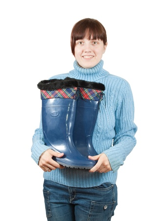 welly:  Woman holding waterproof gum boots. Isolated on  white background