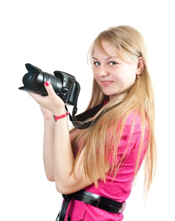 Blonde girl with camera. Isolated over white background photo