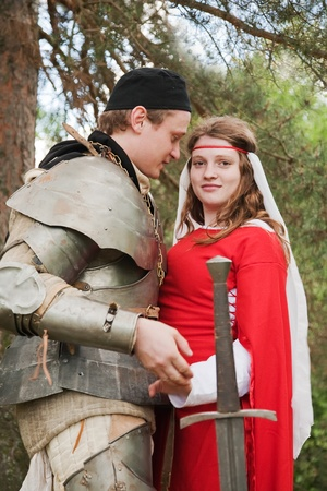 Young medieval couple,  soldier in armour  and maid photo