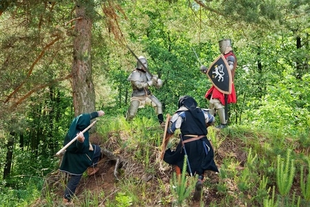 duelling: few knights in armour is fighting  at forest