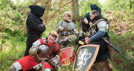 catholicity: Knights in armour resting under the trees at forest