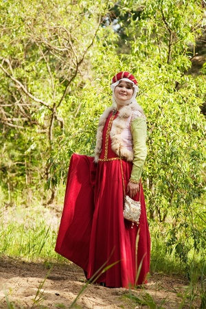 frenchwoman: girl in european historical clothing  of XIII century at nature Stock Photo