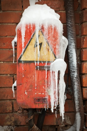 abandoned frosty electrical box with high voltage sign Stock Photo - 9168110