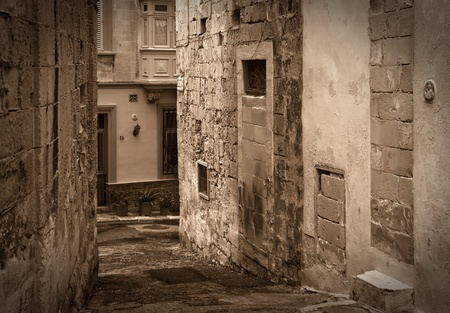 cobblestone street: Retro photo of street in old mediterranean town (Valletta, Malta)