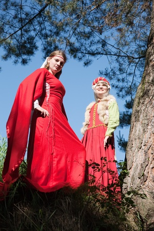 Young women in european historical clothing   at nature photo