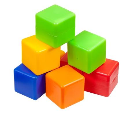 few: Few plastic toy blocks on white background