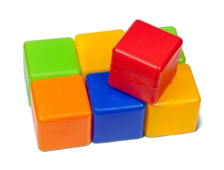 Plastic toy blocks on white background photo