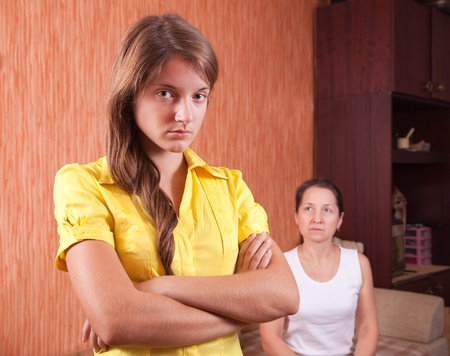 Mother and teen daughter having quarrel at home Stock Photo - 9249025