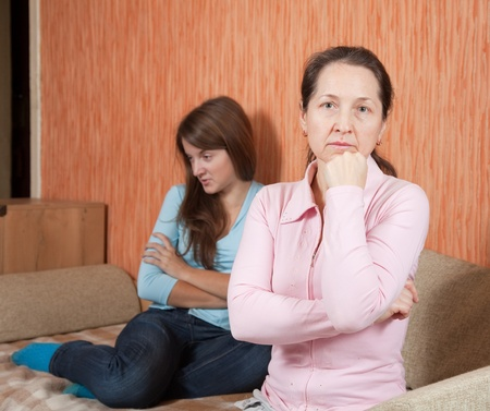 Mature mother and  daughter  after quarrel at home Stock Photo - 9249017