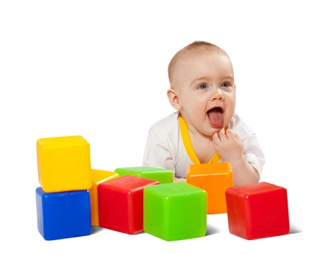 Happy baby plays  with toy blocks over white background Stock Photo - 9248860