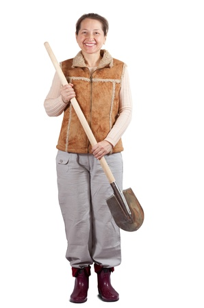 welly: Happy pastoral  woman stands with spade over white Stock Photo