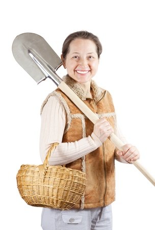 habitual: Happy mature  woman   with spade and basket over white