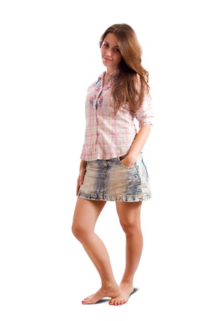 ordinary woman: Isolated full length view of casualy dressed brunette girl