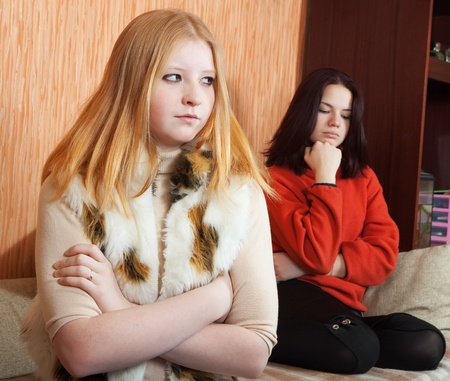 Two young women after quarrel at home photo