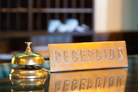 Golden bell on  reception desk in hotel Stock Photo - 9385224