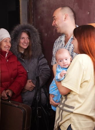 kindred: Family of three is meeting a kinsfolk at home