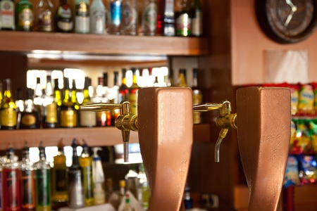 beer taps against  alcohol counter in bar