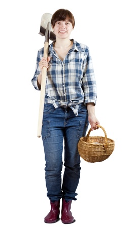Happy young  woman   with spade and basket over white photo