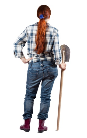 Rear view of female farmer with spade over white background photo