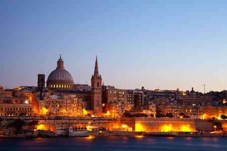 View of Malta. Old Valletta in night Фото со стока