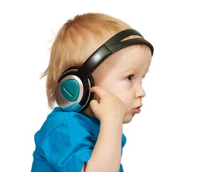 two-year boy in  blue shirt with headphones, isolated on white photo