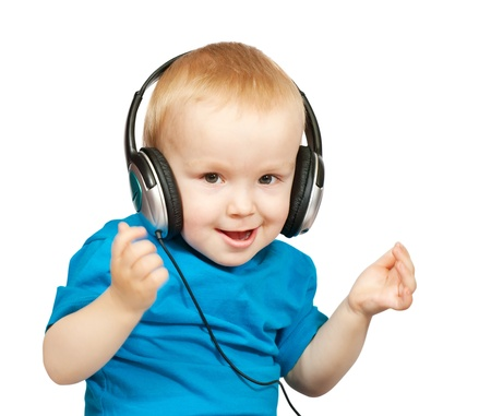 Little boy with headphones over white background photo