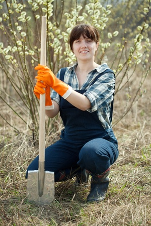 Female farmer  with spade in spring outdoor photo