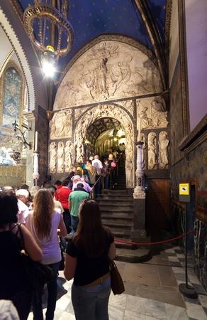 worshipers: SANTA MARIA DE MONTSERRAT, SPAIN - APRIL 9 : Worshipers during worship in church on April 9, 2011, Montserrat mountain, Spain.  Line of people at the statue of Santa Maria de Montserrat