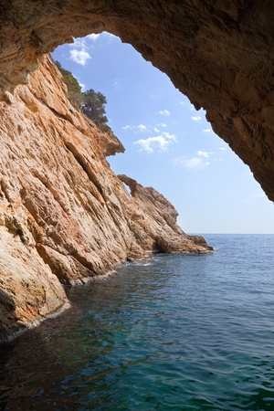 Inside view of grotto in cliff. Nature composition photo