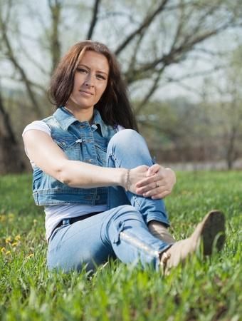 middle ages woman  in  blue jeans at meadow Stock Photo - 9490575