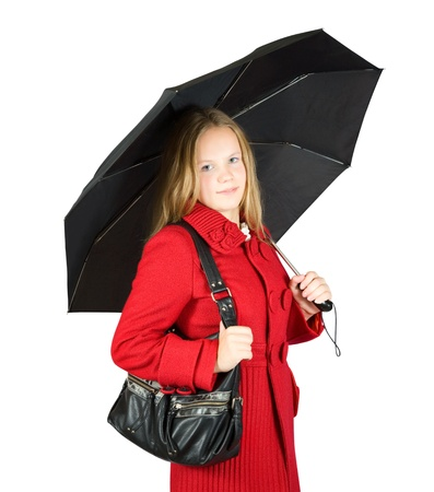 Pretty  girl in red coat with black umbrella. Isolated over white