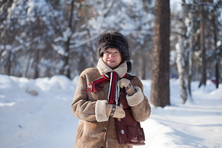 Portrait of  mature woman in winter park