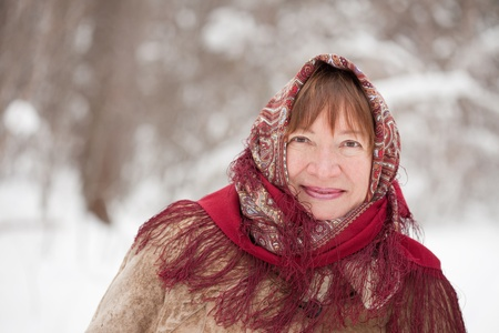 sudarium: Outdoor wintry portrait of mature woman in babushka Stock Photo