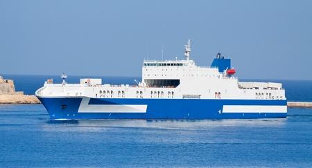 Cargo ship going in to Grand harbour (Valleta, Malta) photo