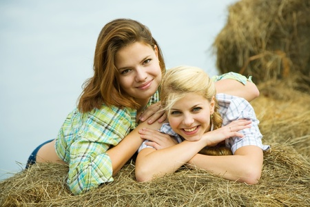Portrait of country girls on hay in summer Stock Photo - 9547050